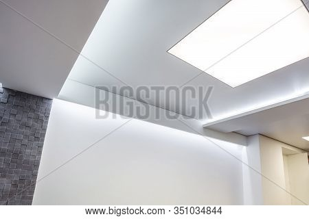 Halogen Spots Lamps On Suspended Ceiling And Drywall Construction In In Empty Room In Apartment Or H