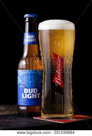 London, Uk - April 27, 2018: Glass Bottle Of Bud Light On Wooden Background With Label, An American
