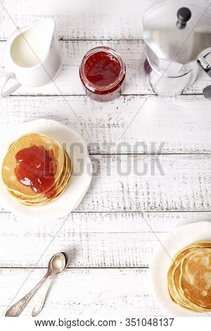 Tasty Breakfast. Pancakes With Strawberry Confiture And Butter. Selective Focus.
