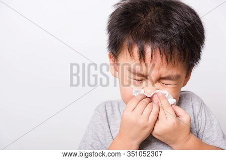 Closeup Asian Face, Little Children Boy Cleaning Nose With Tissue On White Background With Copy Spac