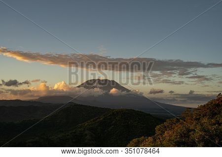 Grassy Hills With Dormant Volcano On Background