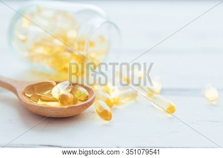 Pill Capsules Omega 3 And Many Other Of Capsules With Bottle Blurred Background. Vitamin D-3 Capsule
