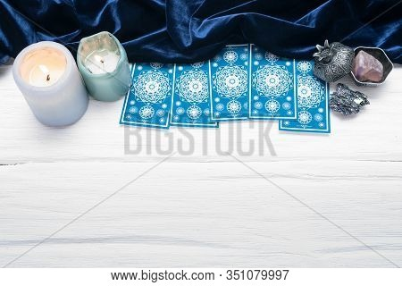Blue Tarot Cards On White Table Background With Copy Space.