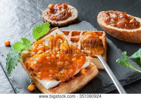 Thick Sliced Homemade Wafer And Bread Broiled With Butter Served With Sea Buckthorn Jam Preserves On