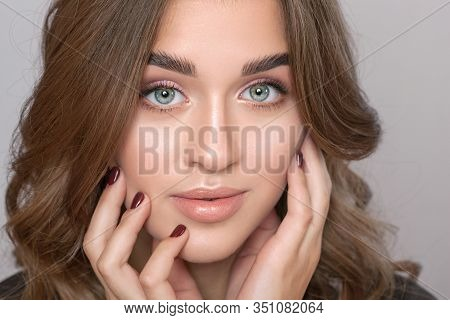 Portrait Of A Beautiful Happy Woman With Long Eyelashes, Beautiful Fresh Nude Make-up, Thick Eyebrow