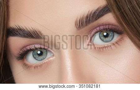 Beautiful Woman With Long Eyelashes, Beautiful Make-up And Thick Eyebrows. Beautiful Blue Eyes Close