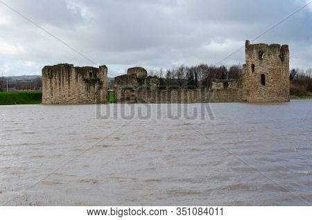 Flint Castle In Flintshire, North Wales With An Unusually High Spring Tide. The Flood Water Of The N
