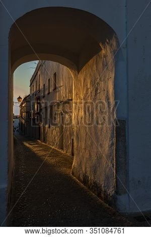 The Photo Shows A Gate In The Evening Sun And Can Be Used For Concepts