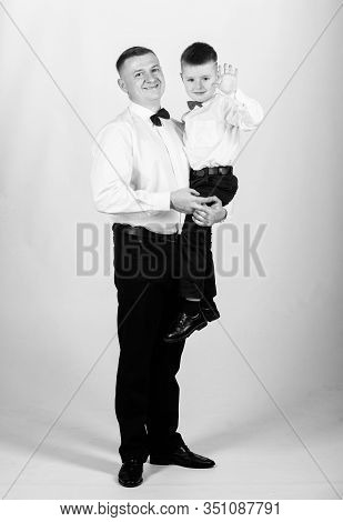Father Carry Hug Son Formal Clothes Outfit. Grow Up Gentleman. Gentleman Upbringing. Little Son Foll