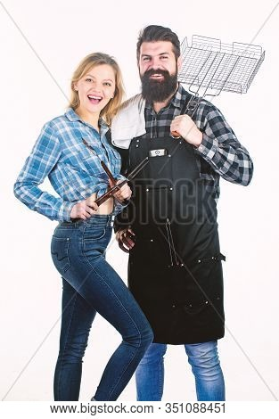Kings Of The Grill. Cooking With Bbq Grill. Couple Of Man And Woman Holding Bbq Set. Bbq Is A Cookin