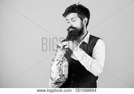 Drawing Out Money For Running Startup Business. Startup Concept. Businessman Taking Money Out Of Gla