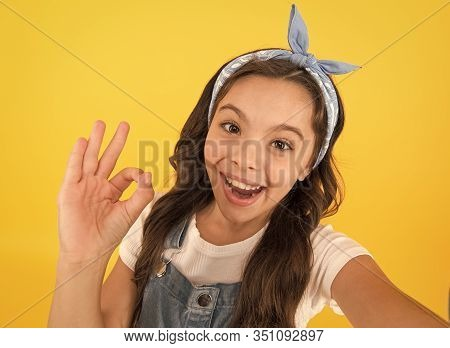Its Ok. Happy Little Child With Ok Hand On Yellow Background. Small Girl Smiling With Ok Gesture. Ok