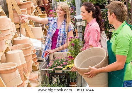 Male worker at garden centre store selling clay pots