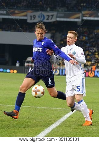 Kyiv, Ukraine - March 15, 2018: Lucas Of Ss Lazio (l) Fights For A Ball With Viktor Tsygankov Of Dyn
