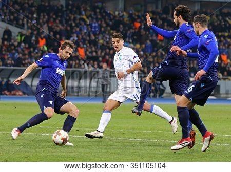 Kyiv, Ukraine - March 15, 2018: Fc Dynamo Kyiv (in White) And Ss Lazio (in Blue) Players Fight For A