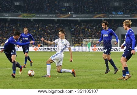 Kyiv, Ukraine - March 15, 2018: Volodymyr Shepeliev Of Dynamo Kyiv (in White) Fights For A Ball With