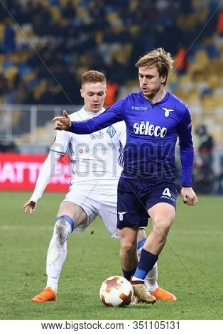 Kyiv, Ukraine - March 15, 2018: Patric Of Ss Lazio (r) Fights For A Ball With Viktor Tsygankov Of Dy