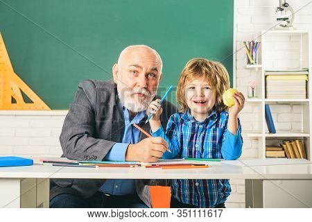 Portrait Of Happy Grandfather And Son In Classroom. Grandfather And Grandchild - Generation People C