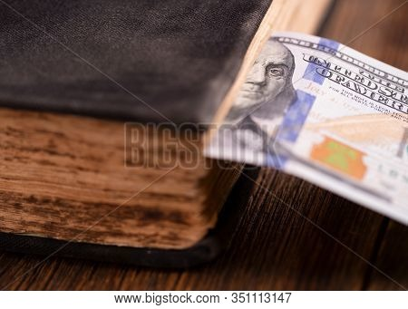 Dollar Bill Used As A Bookmark In A Book. One Hundred Us Dollars. Hundred Dollar Bill Inserted In An