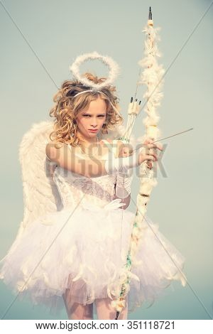 Valentines Day. Angel Child Girl With Curly Blonde Hair. Charming Curly Little Girl In White Dress A