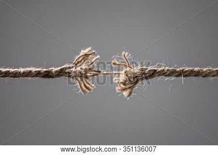 Frayed rope about to break concept for stress, problem, fragility or precarious business situation