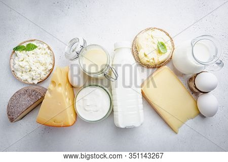 Fresh Dairy Products, Milk, Cottage Cheese, Eggs, Yogurt, Sour Cream And Butter On White Background,