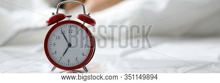Closeup Of Old Fashioned Retro Design Of Alarm And Female Sleeping On Sofa. Oversleeping Girl Enjoyi
