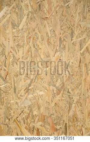 Pressed Wooden Osb Panel Background. Vertical Texture Of Oriented Strand Board