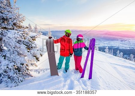 Two Active Friends Snowboarder And Skier Standing On Mountain Top Blue Sky Sunrise. Concept Ski Reso