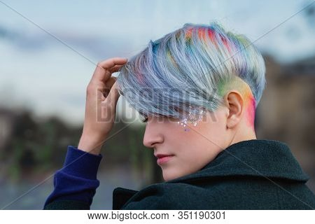 Portrait Of A Young Beautiful Woman In Green Coat With A Short Haircut And Dyed Hair. Grey Main Colo