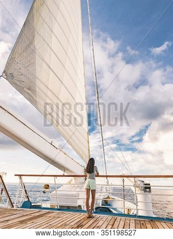 Luxury cruise ship vacation woman tourist sailing in paradise. Travel in Tahiti on sail boat, exotic destination. Tourism in oceania. Yacht passenger traveling on tropical holiday in French Polynesia.
