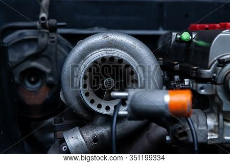 Turbo Charger Installed On Car Engine For Power Booster Torque Drive. Auto Service Industry For Raci