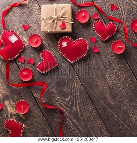 Festive Composition Of Candles, Red Hearts And Inscription Happy Valentine's Day