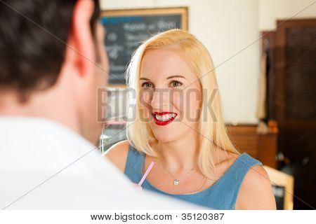 Attractive couple in cafe or coffeeshop and have a chat