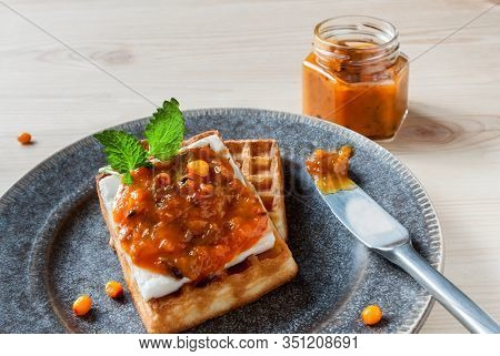 Top View Thick Sliced Homemade Wafer Broiled Served With Sea Buckthorn Jam And Glass Jar Preserves O