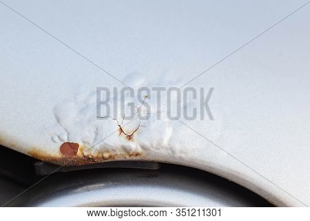 Corrosion And Rust On The Hood Of A Car. The Concept Of Anti-corrosion Treatment Of The Car Body, Ma