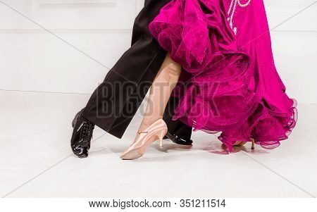 Partner Dance. Close Up Of Dancers Feet. Ballroom Dancers On The Dance Floor.