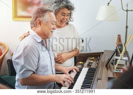Senior Elderly Man Plays Piano In Nursing Home Listened To By Elderly Woman,retreatment Elderly Asia