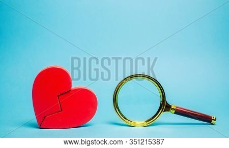 Red Heart And A Magnifying Glass. The Concept Of Finding Love And Relationships. Find A Soul Mate. L