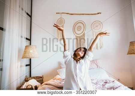 Woman Stretching In Bed After Wake Up.woman Wake Up Happy.