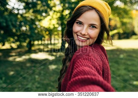 Gorgeous Young Blonde Woman Smiling Broadly With Healthy White Teeth, Wearing A Red Sweater, And A Y