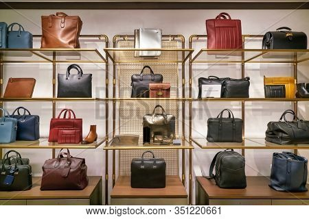 HONG KONG, CHINA - JANUARY 22, 2019: bags on display at a Dunhill store in Hong Kong. Alfred Dunhill Limited is a British luxury goods brand, specialising in menswear, leather goods, and accessories.