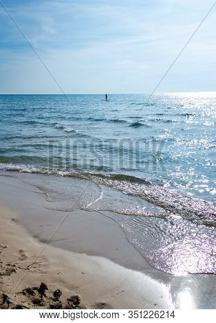Girl On A Sup In The Shore Of Torre San Giovanni. Province Of Lecce, Salento, Apulia, Italy.