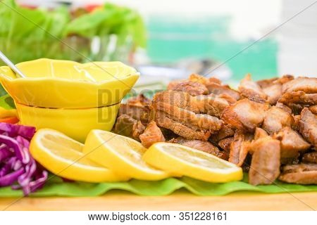 Roasted Slided Pork In Asia Thai Style With Specific Local Sauce Style And Vegetable Cucumber, Green