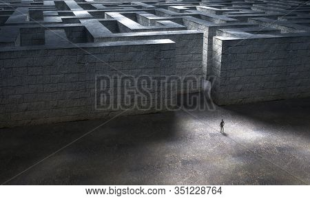 Man Standing At The Entrance Of A Huge Stone Maze. 3d Rendering