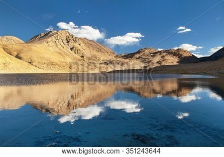 Pamir Mountains Near Pamir Highway, Evening View Of Small Lake And Mounts Mirroring In Lake, Tajikis