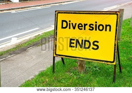 Diversion Ends Sign On Road Works, Road Blocked In Uk City Street. Close Up Of Yellow Diversion Ends