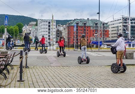 Bergen, Norway - July 22, 2018: A Group Of People On Segways In Protective Helmets Embark On A Journ