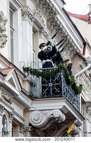Vilnius, Lithuania - Feb 16, 2020: Soldiers Salute With Guns From The Balcony Of The House Of Signat