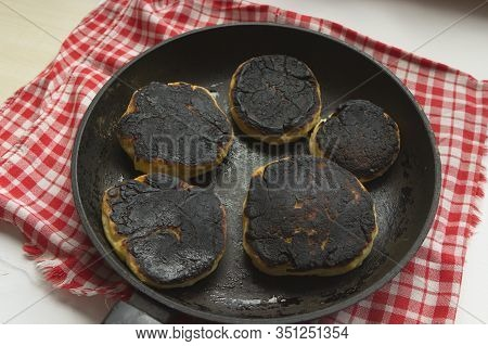 Burnt Pancakes, Cheesecakes, Food In A Pan. Fried Foods Are Unhealthy.